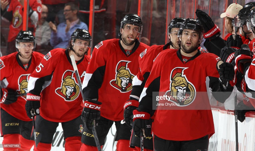 Cory Conacher #89 of the Ottawa Senators celebrates a second period goal against the Buffalo Sabres with team mates Erik Condra #22, Erik Karlsson #65, Jared Cowen #2 and Stephane Da Costa #24 during an NHL game at Canadian Tire Centre on February 6, 2014 in Ottawa, Ontario, Canada.