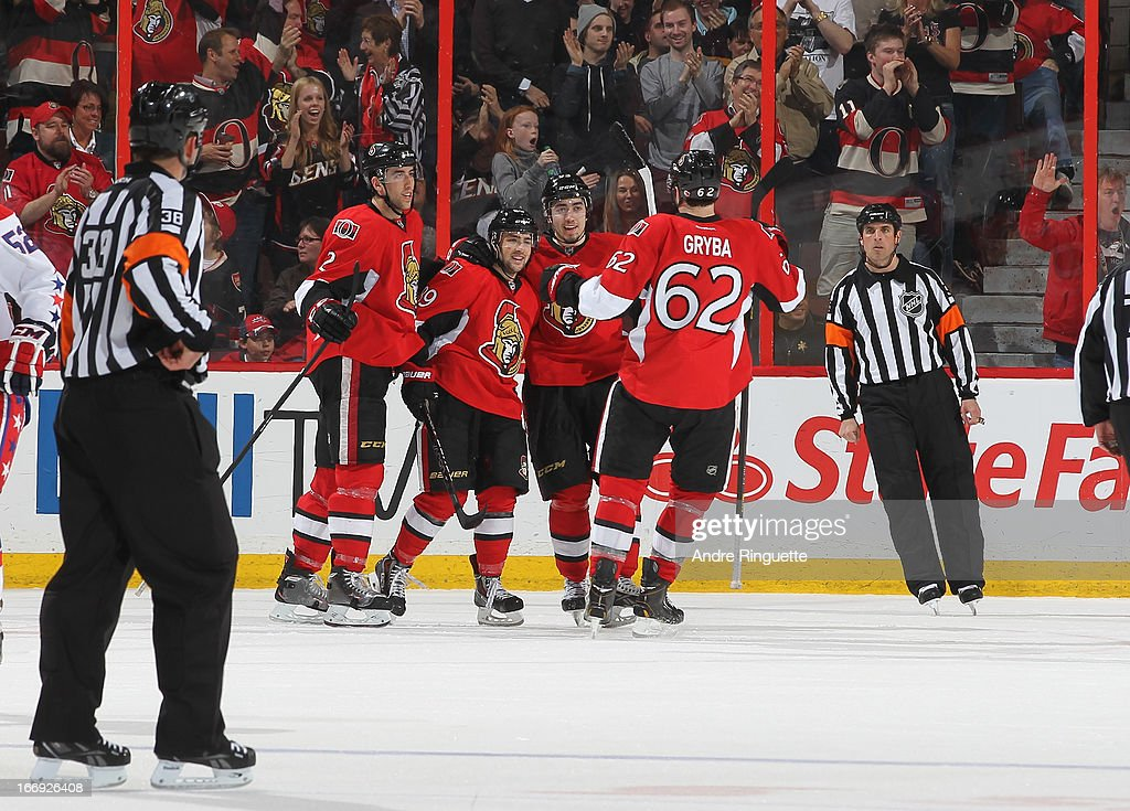 <a gi-track='captionPersonalityLinkClicked' href=/galleries/search?phrase=Cory+Conacher&family=editorial&specificpeople=8312407 ng-click='$event.stopPropagation()'>Cory Conacher</a> #89 of the Ottawa Senators celebrates his second-period goal against the Washington Capitals with teammates <a gi-track='captionPersonalityLinkClicked' href=/galleries/search?phrase=Jared+Cowen&family=editorial&specificpeople=4594191 ng-click='$event.stopPropagation()'>Jared Cowen</a> #2, <a gi-track='captionPersonalityLinkClicked' href=/galleries/search?phrase=Mika+Zibanejad&family=editorial&specificpeople=7832310 ng-click='$event.stopPropagation()'>Mika Zibanejad</a> #93 and <a gi-track='captionPersonalityLinkClicked' href=/galleries/search?phrase=Eric+Gryba&family=editorial&specificpeople=570539 ng-click='$event.stopPropagation()'>Eric Gryba</a> #62 on April 18, 2013 at Scotiabank Place in Ottawa, Ontario, Canada.