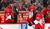 Cory Conacher of the Ottawa Senators celebrates his third period power play goal with teammates Chris Phillips and Matt Kassian against the Montreal...