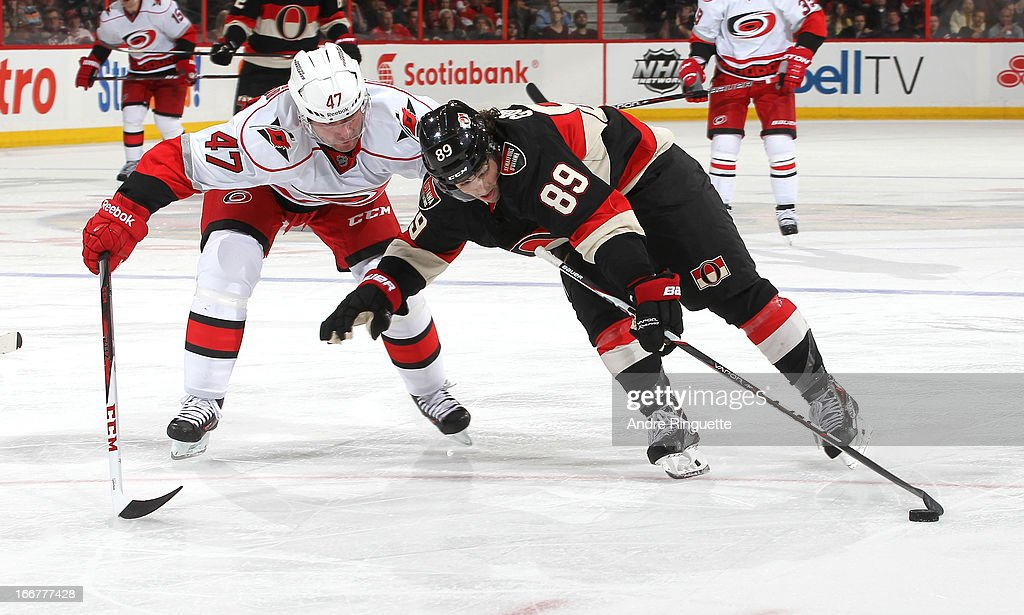 <a gi-track='captionPersonalityLinkClicked' href=/galleries/search?phrase=Cory+Conacher&family=editorial&specificpeople=8312407 ng-click='$event.stopPropagation()'>Cory Conacher</a> #89 of the Ottawa Senators stickhandles the puck as <a gi-track='captionPersonalityLinkClicked' href=/galleries/search?phrase=Marc-Andre+Bergeron&family=editorial&specificpeople=213539 ng-click='$event.stopPropagation()'>Marc-Andre Bergeron</a> #47 of the Carolina Hurricanes throws him off balance on April 16, 2013 at Scotiabank Place in Ottawa, Ontario, Canada.
