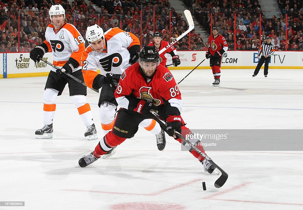 <a gi-track='captionPersonalityLinkClicked' href=/galleries/search?phrase=Cory+Conacher&family=editorial&specificpeople=8312407 ng-click='$event.stopPropagation()'>Cory Conacher</a> #89 of the Ottawa Senators stickhandles the puck away from <a gi-track='captionPersonalityLinkClicked' href=/galleries/search?phrase=Scott+Hartnell&family=editorial&specificpeople=201889 ng-click='$event.stopPropagation()'>Scott Hartnell</a> #19 and Brandon Manning #32 of the Philadelphia Flyers on April 27, 2013 at Scotiabank Place in Ottawa, Ontario, Canada.