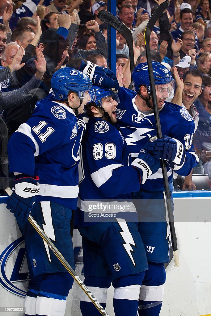 Cory Conacher #89 of the Tampa Bay Lightning celebrates his first NHL goal with teammates <a gi-track='captionPersonalityLinkClicked' href=/galleries/search?phrase=Tom+Pyatt&family=editorial&specificpeople=2079036 ng-click='$event.stopPropagation()'>Tom Pyatt</a> #11 and <a gi-track='captionPersonalityLinkClicked' href=/galleries/search?phrase=Teddy+Purcell&family=editorial&specificpeople=4537302 ng-click='$event.stopPropagation()'>Teddy Purcell</a> #16 during the third period against the Washington Capitals at the Tampa Bay Times Forum on January 19, 2013 in Tampa, Florida.