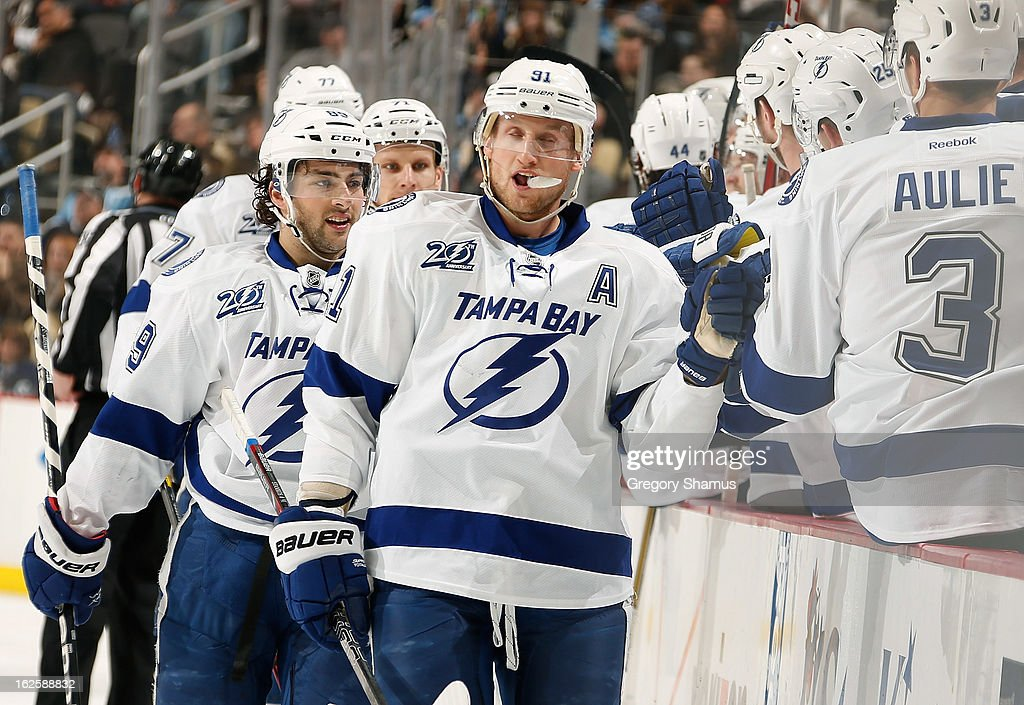 Cory Conacher #89 of the Tampa Bay Lightning celebrates his goal with the bench during the game against the Pittsburgh Penguins on February 24, 2013 at Consol Energy Center in Pittsburgh, Pennsylvania.