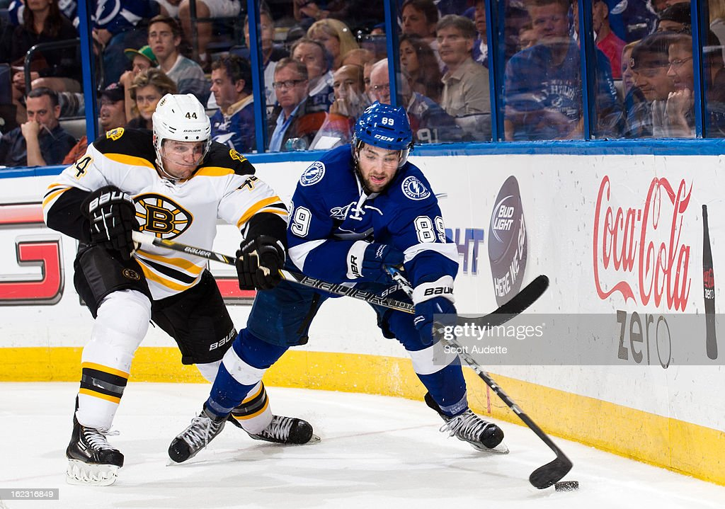 Cory Conacher #89 of the Tampa Bay Lightning fights for control of the puck with <a gi-track='captionPersonalityLinkClicked' href=/galleries/search?phrase=Dennis+Seidenberg&family=editorial&specificpeople=204616 ng-click='$event.stopPropagation()'>Dennis Seidenberg</a> #44 of the Boston Bruins during the third period of the game at the Tampa Bay Times Forum on February 21, 2013 in Tampa, Florida.