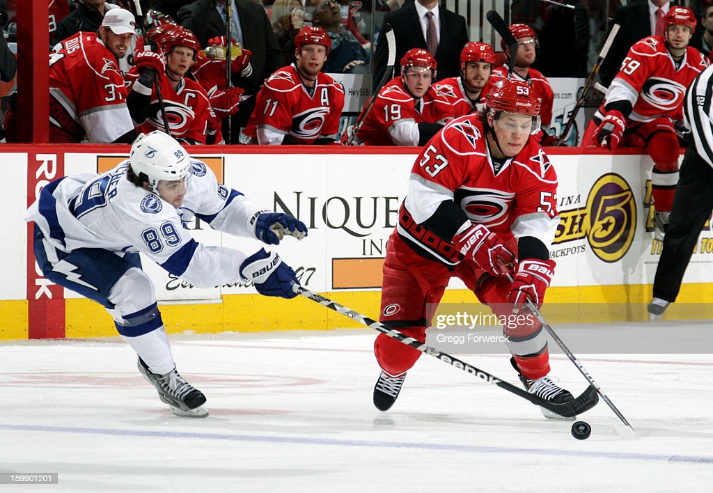 Cory Conacher #89 of the Tampa Bay Lightning knocks the puck off the stick of Jeff Skinner #53 of the Carolina Hurricanes during an NHL game on January 22, 2013 at PNC Arena in Raleigh, North Carolina.