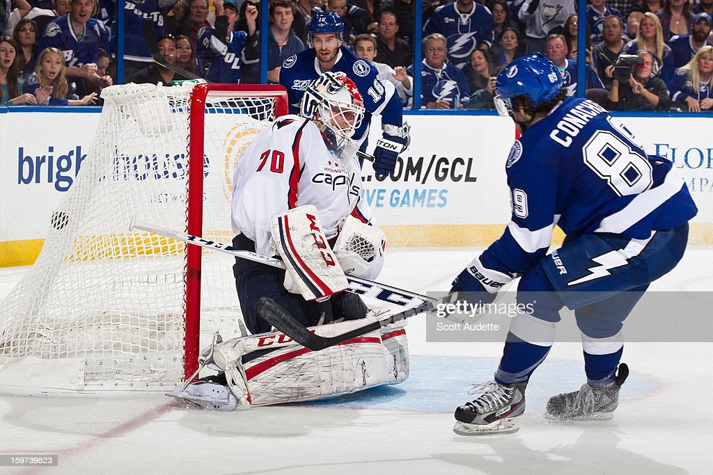 Cory Conacher #89 of the Tampa Bay Lightning scores his first NHL goal against <a gi-track='captionPersonalityLinkClicked' href=/galleries/search?phrase=Braden+Holtby&family=editorial&specificpeople=5370964 ng-click='$event.stopPropagation()'>Braden Holtby</a> #70 of the Washington Capitals during the third period at the Tampa Bay Times Forum on January 19, 2013 in Tampa, Florida.