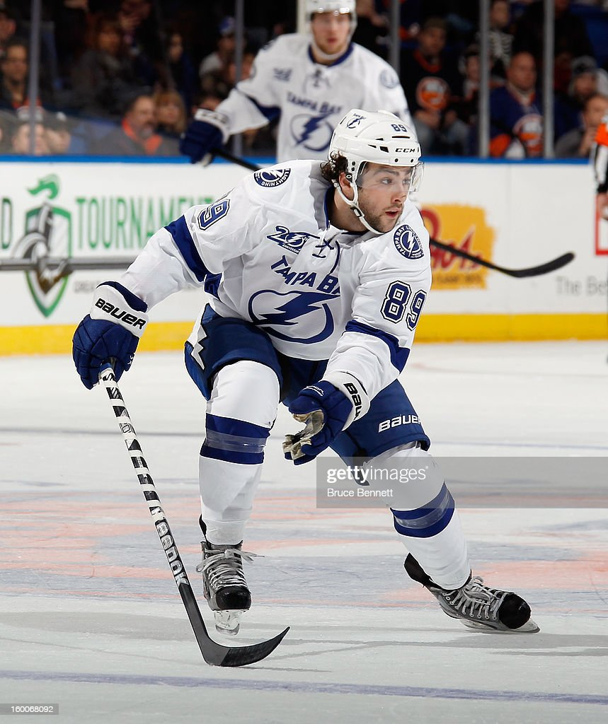 Cory Conacher #89 of the Tampa Bay Lightning skates against the New York Islanders at the Nassau Veterans Memorial Coliseum on January 21, 2013 in Uniondale, New York.