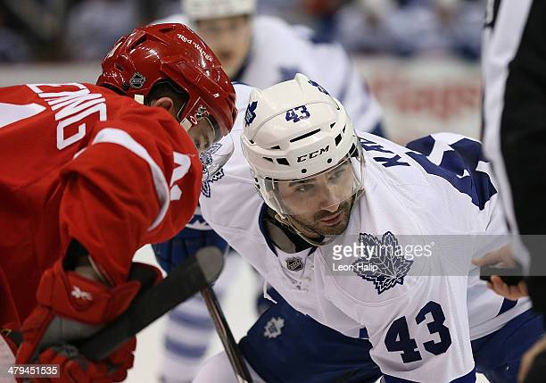 Cory Emmerton of the Detroit Red Wings and Nazem Kadri of the Toronto Maple Leafs face off during the second period of the game at Joe Louis Arena on...