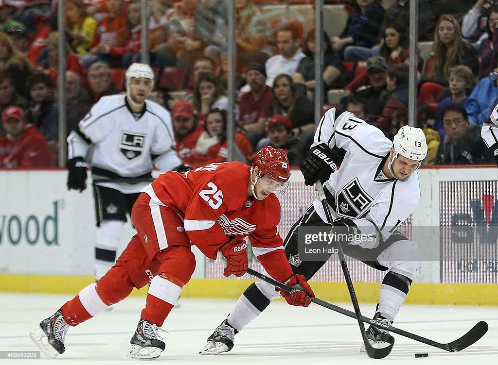 <a gi-track='captionPersonalityLinkClicked' href=/galleries/search?phrase=Cory+Emmerton&family=editorial&specificpeople=570505 ng-click='$event.stopPropagation()'>Cory Emmerton</a> #25 of the Detroit Red Wings battles for the puck against <a gi-track='captionPersonalityLinkClicked' href=/galleries/search?phrase=Kyle+Clifford&family=editorial&specificpeople=4640225 ng-click='$event.stopPropagation()'>Kyle Clifford</a> #13 of the Los Angeles Kings during the third period of the game at Joe Louis Arena on January 18, 2014 in Detroit, Michigan. The Wings defeated the Kings 3-2 in a shootout.