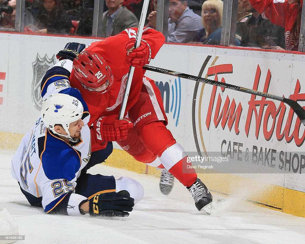 <a gi-track='captionPersonalityLinkClicked' href=/galleries/search?phrase=Cory+Emmerton&family=editorial&specificpeople=570505 ng-click='$event.stopPropagation()'>Cory Emmerton</a> #25 of the Detroit Red Wings battles for the puck with Chris Stewart #25 of the St Louis Blues during a NHL game at Joe Louis Arena on February 13, 2013 in Detroit, Michigan.