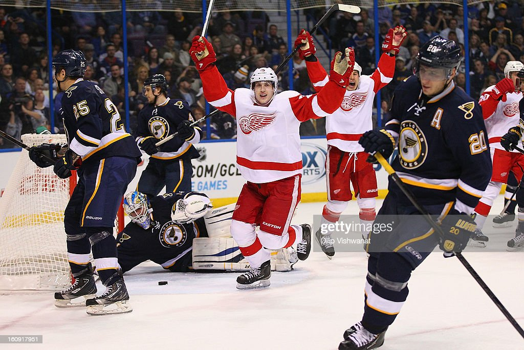 <a gi-track='captionPersonalityLinkClicked' href=/galleries/search?phrase=Cory+Emmerton&family=editorial&specificpeople=570505 ng-click='$event.stopPropagation()'>Cory Emmerton</a> #25 of the Detroit Red Wings celebrates his goal against the St. Louis Blues at the Scottrade Center on February 7, 2013 in St. Louis, Missouri.