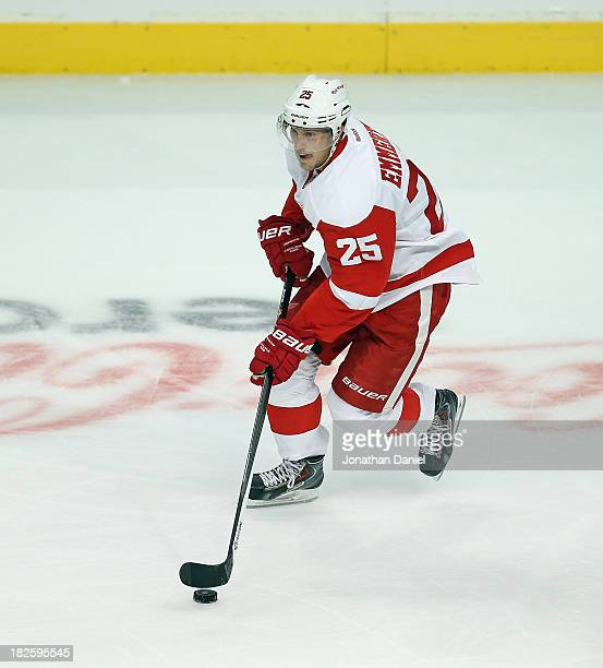 Cory Emmerton of the Detroit Red Wings controls the puck against the Chicago Blackhawks during an exhibition game at United Center on September 17...