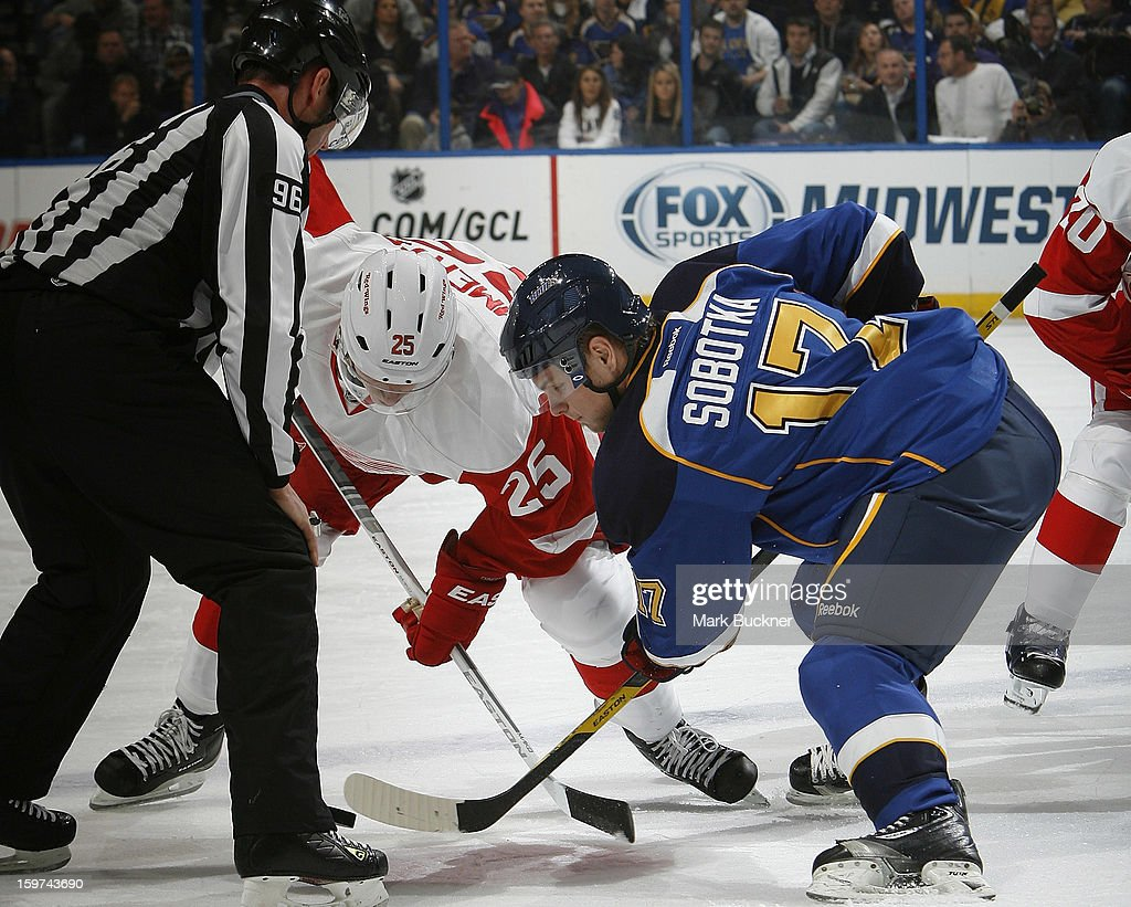 Cory Emmerton #25 of the Detroit Red Wings faces off against <a gi-track='captionPersonalityLinkClicked' href=/galleries/search?phrase=Vladimir+Sobotka&family=editorial&specificpeople=716736 ng-click='$event.stopPropagation()'>Vladimir Sobotka</a> #17 of the St. Louis Blues in an NHL game on January 19, 2013 at Scottrade Center in St. Louis, Missouri.