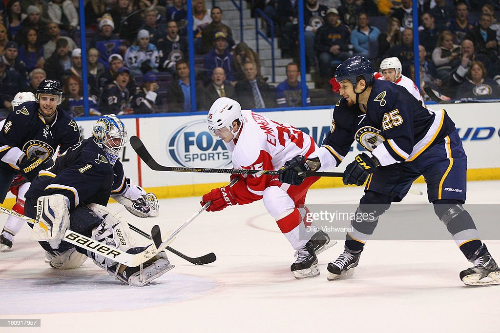 <a gi-track='captionPersonalityLinkClicked' href=/galleries/search?phrase=Cory+Emmerton&family=editorial&specificpeople=570505 ng-click='$event.stopPropagation()'>Cory Emmerton</a> #25 of the Detroit Red Wings scores a goal against Chris Stewart #25 and <a gi-track='captionPersonalityLinkClicked' href=/galleries/search?phrase=Brian+Elliott&family=editorial&specificpeople=687032 ng-click='$event.stopPropagation()'>Brian Elliott</a> #1 both of the St. Louis Blues at the Scottrade Center on February 7, 2013 in St. Louis, Missouri.