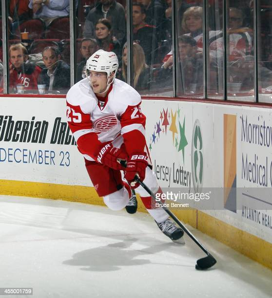 Cory Emmerton of the Detroit Red Wings skates against the New Jersey Devils at the Prudential Center on December 6 2013 in Newark New Jersey