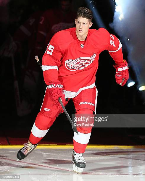 Cory Emmerton of the Detroit Red Wings skates onto the ice after being introduced for the pregame ceremonies before an NHL game against the Buffalo...