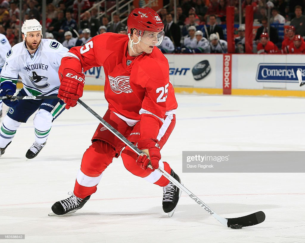 <a gi-track='captionPersonalityLinkClicked' href=/galleries/search?phrase=Cory+Emmerton&family=editorial&specificpeople=570505 ng-click='$event.stopPropagation()'>Cory Emmerton</a> #25 of the Detroit Red Wings skates with the puck during a NHL game against the Vancouver Canucks at Joe Louis Arena on February 24, 2013 in Detroit, Michigan.