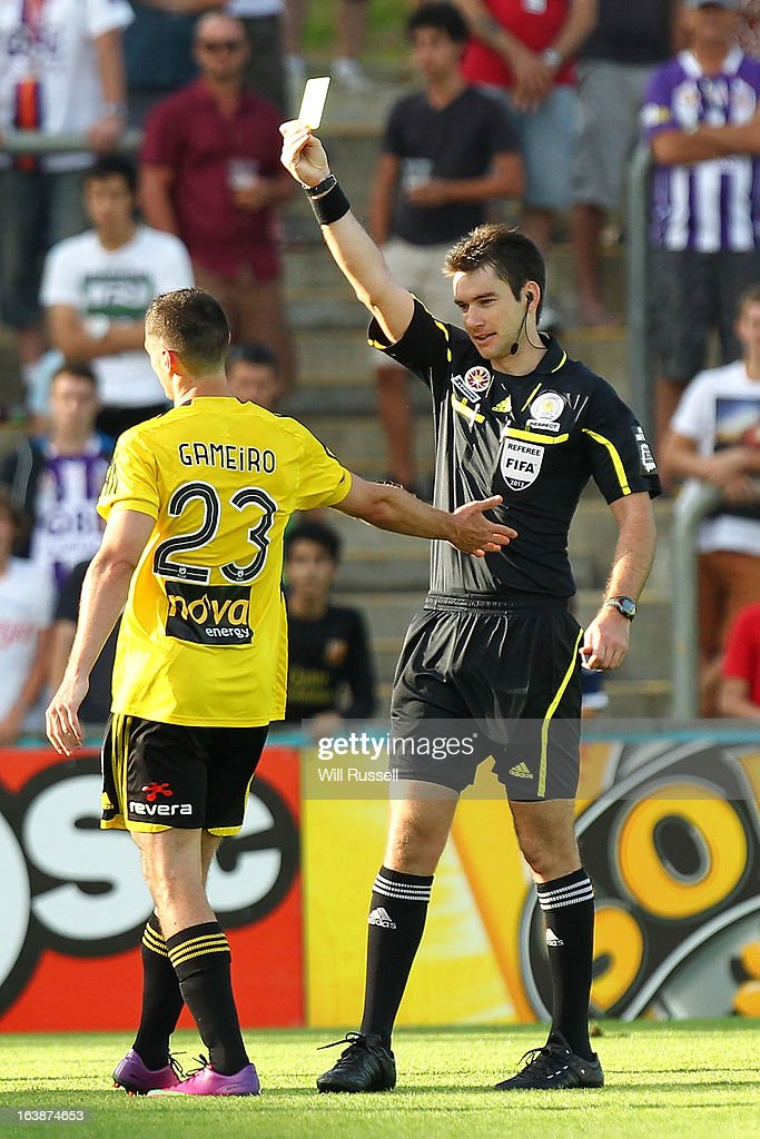 Cory Gameiro of the Wellington Phoenix is shown the yellow card during the round 25 A-League match between the Perth Glory and the Wellington Phoenix at nib Stadium on March 17, 2013 in Perth, Australia.