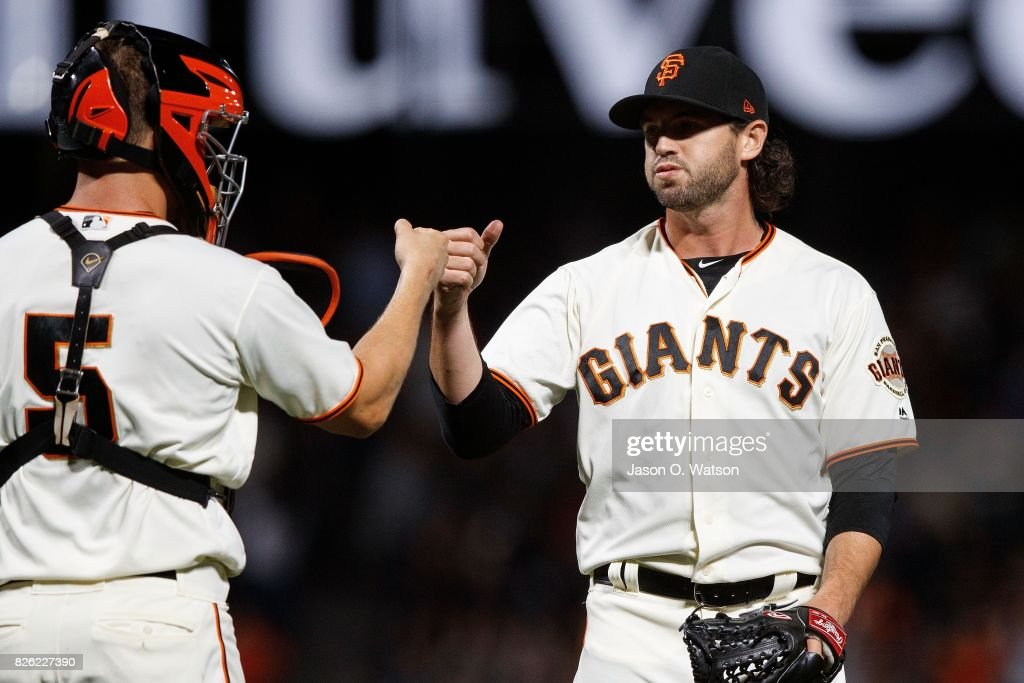 Cory Gearrin #62 of the San Francisco Giants and Nick Hundley #5 celebrate after the game against the Oakland Athletics at AT&T Park on August 3, 2017 in San Francisco, California. The San Francisco Giants defeated the Oakland Athletics 11-2.