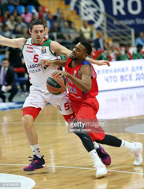 Cory Higgins #22 of CSKA Moscow competes with Fabien Causeur #5 of Laboral Kutxa Vitoria Gasteiz in action during the 20152016 Turkish Airlines...