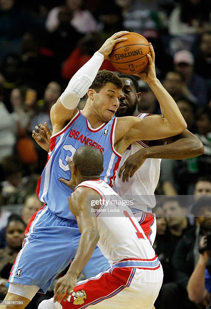 Cory Higgins #11 of the Charlotte Bobcats and teammate Reggie Williams #55 try to stop Blake Griffin #32 of the Los Angeles Clippers during their game at Time Warner Cable Arena on February 11, 2012 in Charlotte, North Carolina.