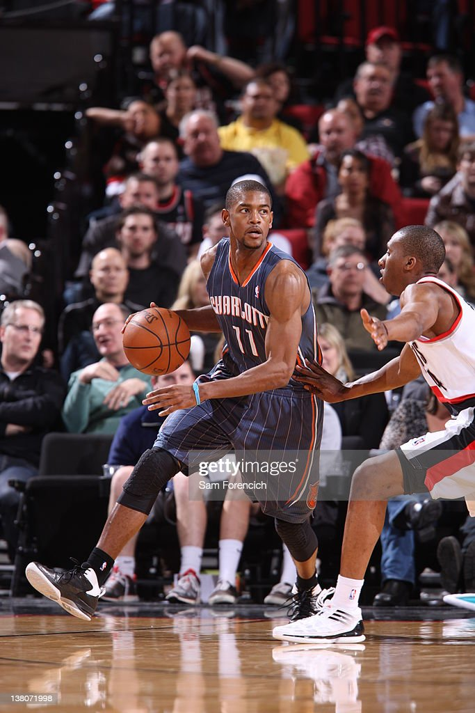 Cory Higgins #11 of the Charlotte Bobcats controls the ball against <a gi-track='captionPersonalityLinkClicked' href=/galleries/search?phrase=Nolan+Smith&family=editorial&specificpeople=4215916 ng-click='$event.stopPropagation()'>Nolan Smith</a> #4 of the Portland Trail Blazers on February 1, 2012 at the Rose Garden Arena in Portland, Oregon.