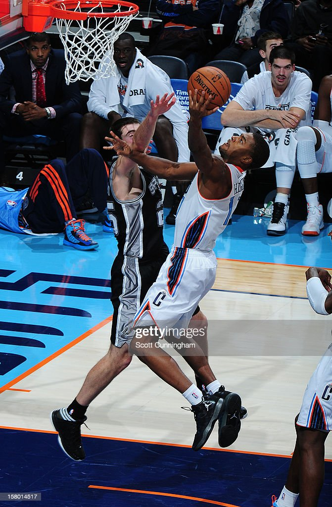 Cory Higgins #11 of the Charlotte Bobcats drives to the basket against the San Antonio Spurs at Time Warner Cable Arena on December expressly acknowledges and agrees that, by downloading and/or using this Photograph, user is consenting to the terms and conditions of the Getty Images License Agreement. Mandatory Copyright Notice: Copyright 2012 NBAE.
