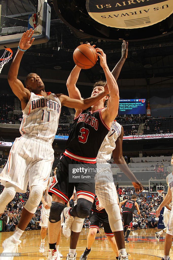 Cory Higgins #11 of the Charlotte Bobcats gets the block against Omer Asik #3 of the Chicago Bulls during the game at the Time Warner Cable Arena on February 10, 2012 in Charlotte, North Carolina.