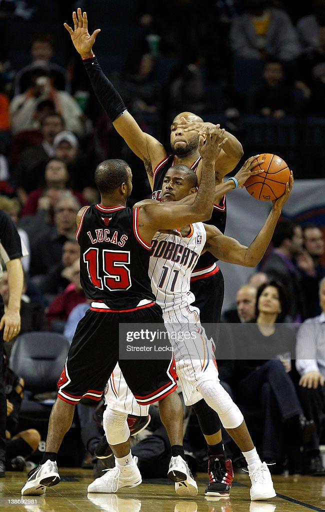 Cory Higgins #11 of the Charlotte Bobcats is trapped by teammates John Lucas #15 of the Chicago Bulls and <a gi-track='captionPersonalityLinkClicked' href=/galleries/search?phrase=Taj+Gibson&family=editorial&specificpeople=4029461 ng-click='$event.stopPropagation()'>Taj Gibson</a> #22 during their game at Time Warner Cable Arena on February 10, 2012 in Charlotte, North Carolina.