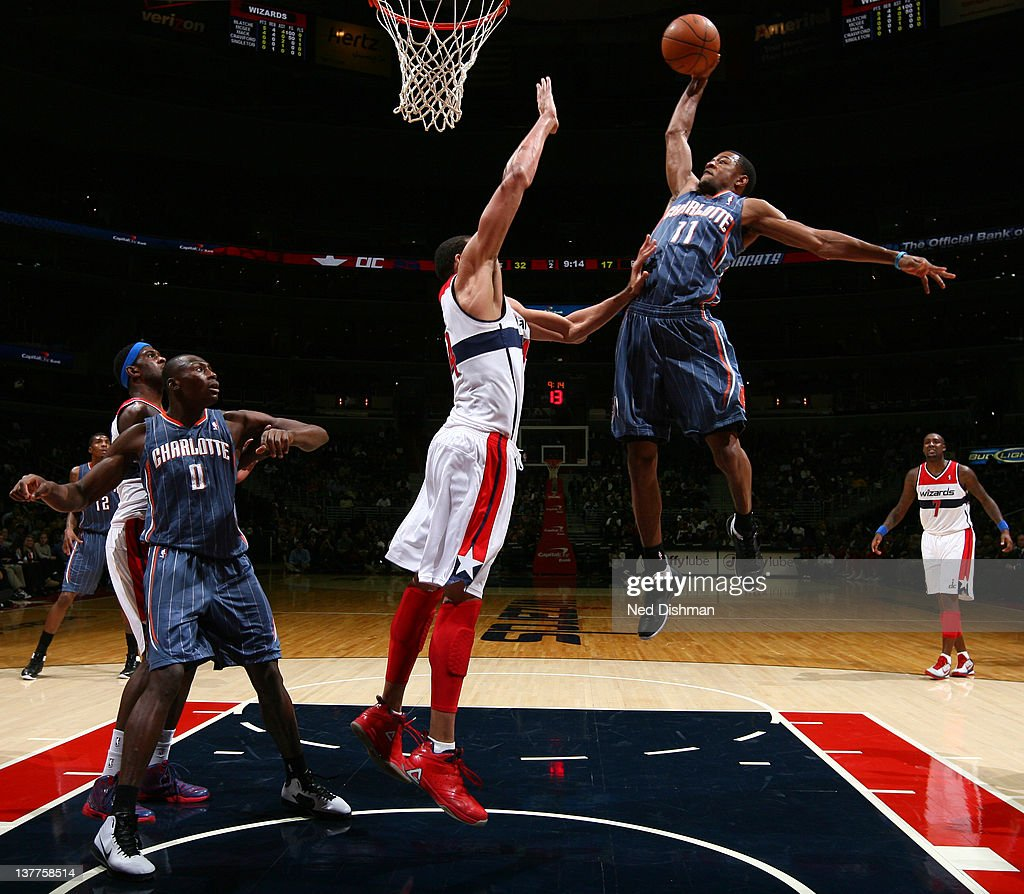 Cory Higins #11 of the Charlotte Bobcats dunks against <a gi-track='captionPersonalityLinkClicked' href=/galleries/search?phrase=JaVale+McGee&family=editorial&specificpeople=4195625 ng-click='$event.stopPropagation()'>JaVale McGee</a> #34 of the Washington Wizards during the game at the Verizon Center on January 25, 2012 in Washington, DC.
