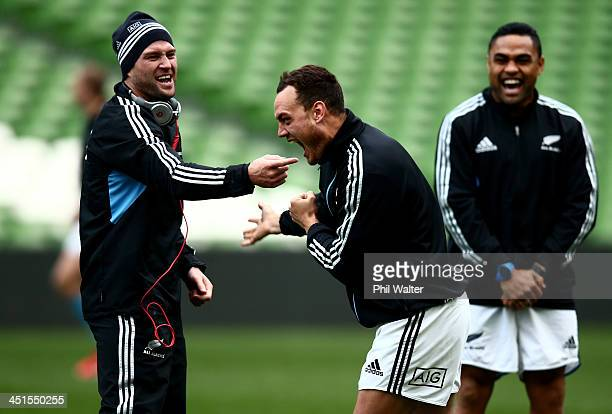 Cory Jane and Israel Dagg of the All Blacks joke around as Francis Saili looks on during the New Zealand All Blacks Captains Run at Aviva Stadium on...