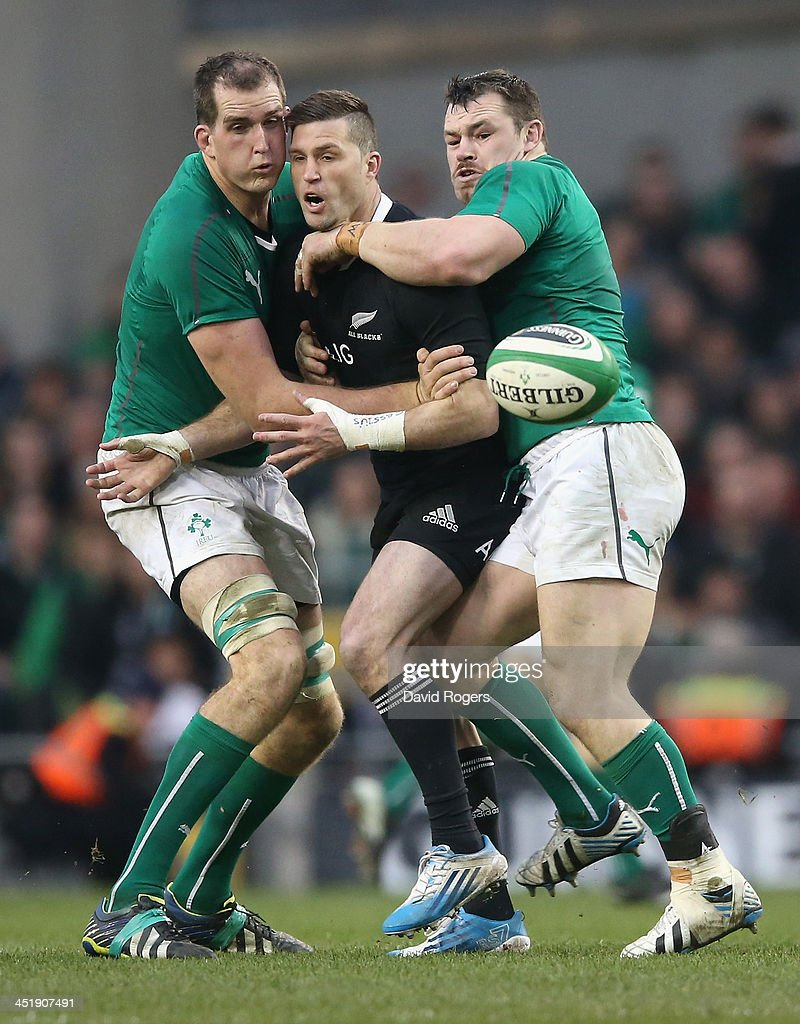 Cory Jane of the All Blacks is tackled by Cian Healy and Devin Toner during the International match between Ireland and New Zealand All Blacks at the...