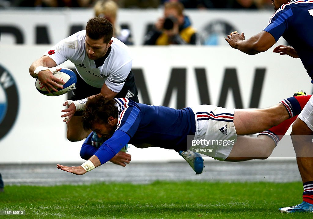 <a gi-track='captionPersonalityLinkClicked' href=/galleries/search?phrase=Cory+Jane&family=editorial&specificpeople=601531 ng-click='$event.stopPropagation()'>Cory Jane</a> of the All Blacks is tackled out of touch by Maxime Medard of France during the international test match between France and the New Zealand All Blacks at Stade de France on November 9, 2013 in Paris, France.