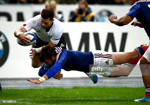 Cory Jane of the All Blacks is tackled out of touch by Maxime Medard of France during the international test match between France and the New Zealand...