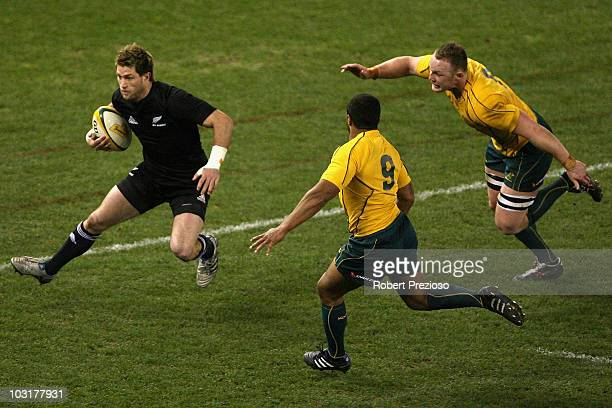Cory Jane of the All Blacks runs towards the try line during the 2010 TriNations Bledisloe Cup match between the Australian Wallabies and the New...