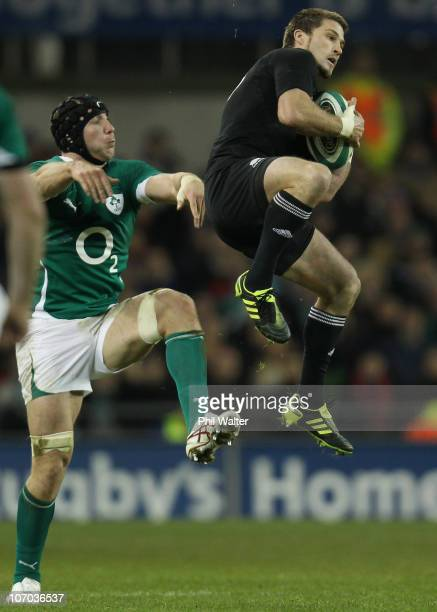 Cory Jane of the All Blacks takes the high ball under pressure from Stephen Ferris of Ireland during the Test match between Ireland and the New...