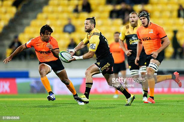 Cory Jane of the Hurricanes looks to pass during the round seven Super Rugby match between the Hurricanes and the Jaguares at Westpac Stadium on...