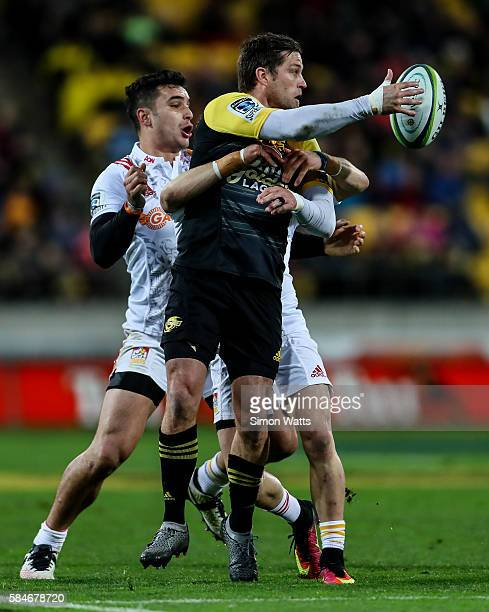 Cory Jane of the Hurricanes offloads the ball during the Super Rugby Semi Final match between the Hurricanes and the Chiefs at Westpac Stadium on...