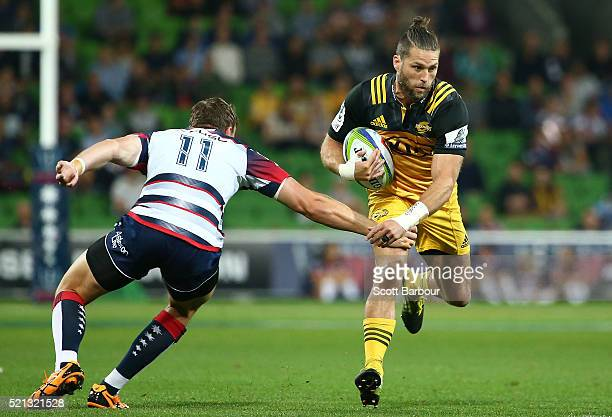 Cory Jane of the Hurricanes runs with the ball during the round eight Super Rugby match between the Rebels and the Hurricanes at AAMI Park on April...