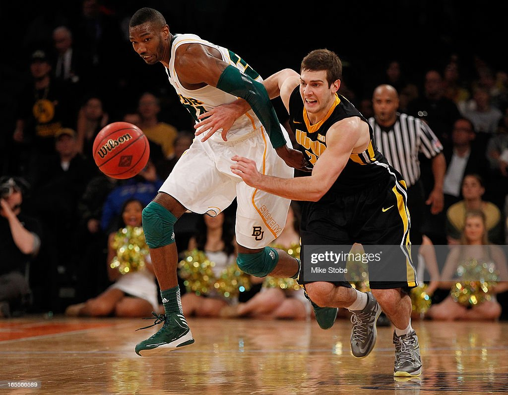 Cory Jefferson #34 of the Baylor Bears and Eric May #25 of the Iowa Hawkeyes pursue the loose ball during the 2013 NIT Championship at Madison Square Garden on April 4, 2013 in New York City. Baylor defeated Iowa 74-54.