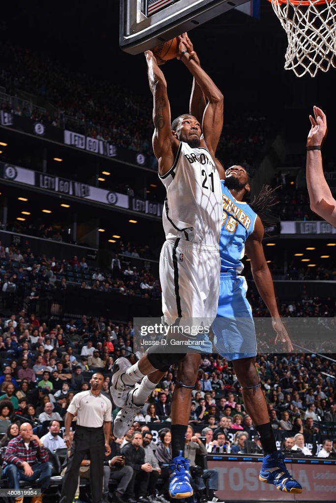 <a gi-track='captionPersonalityLinkClicked' href=/galleries/search?phrase=Cory+Jefferson&family=editorial&specificpeople=8783017 ng-click='$event.stopPropagation()'>Cory Jefferson</a> #21 of the Brooklyn Nets drives to the basket against <a gi-track='captionPersonalityLinkClicked' href=/galleries/search?phrase=Kenneth+Faried&family=editorial&specificpeople=5765135 ng-click='$event.stopPropagation()'>Kenneth Faried</a> #35 of the Denver Nuggets on December 23, 2014 at the Barclays Center in Brooklyn, NY.