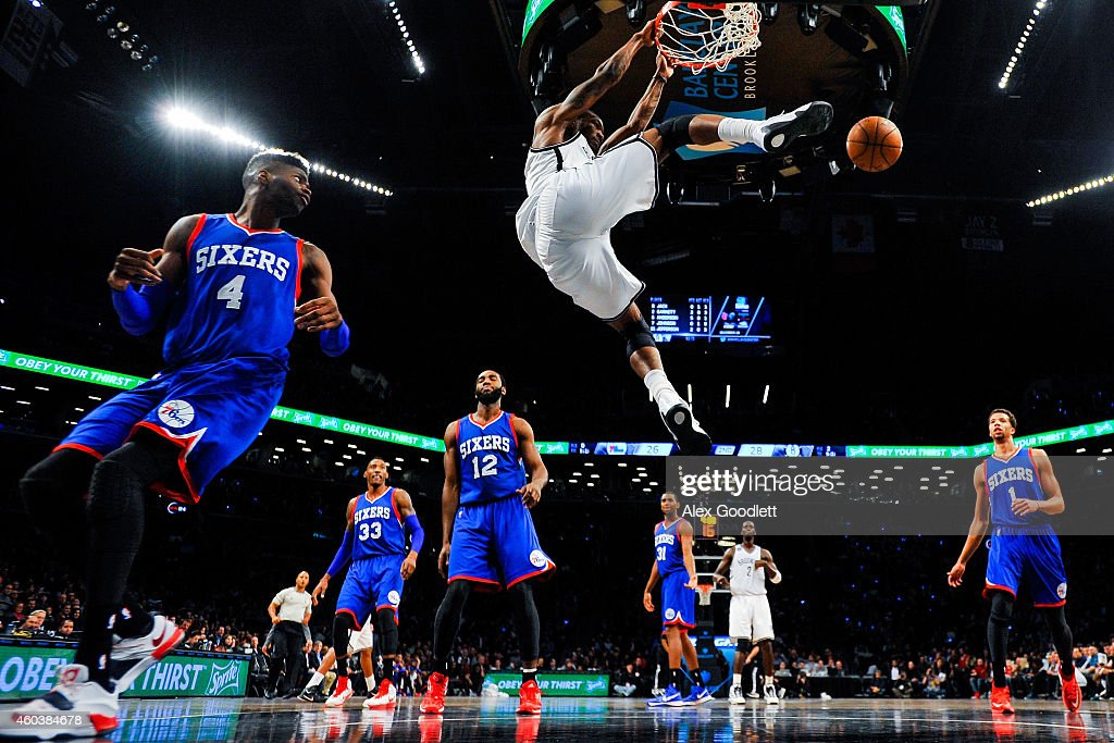 <a gi-track='captionPersonalityLinkClicked' href=/galleries/search?phrase=Cory+Jefferson&family=editorial&specificpeople=8783017 ng-click='$event.stopPropagation()'>Cory Jefferson</a> #21 of the Brooklyn Nets dunks over <a gi-track='captionPersonalityLinkClicked' href=/galleries/search?phrase=Nerlens+Noel&family=editorial&specificpeople=7880842 ng-click='$event.stopPropagation()'>Nerlens Noel</a> #4 of the Philadelphia 76ers in the first half at the Barclays Center on December 12, 2014 in the Brooklyn borough of New York City.