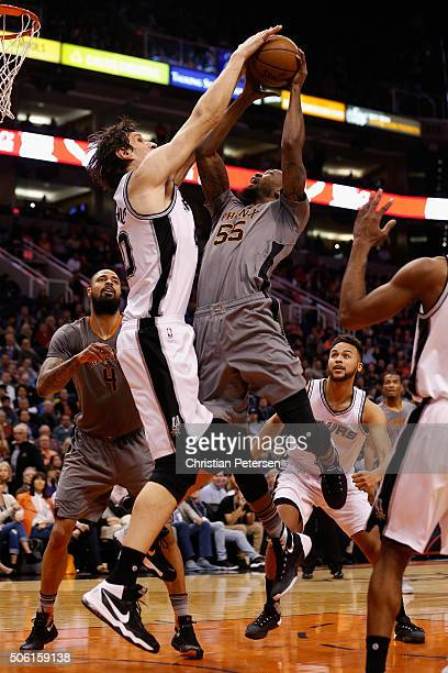 Cory Jefferson of the Phoenix Suns has a shot blocked by Boban Marjanovic of the San Antonio Spurs during the first half of the NBA game at Talking...