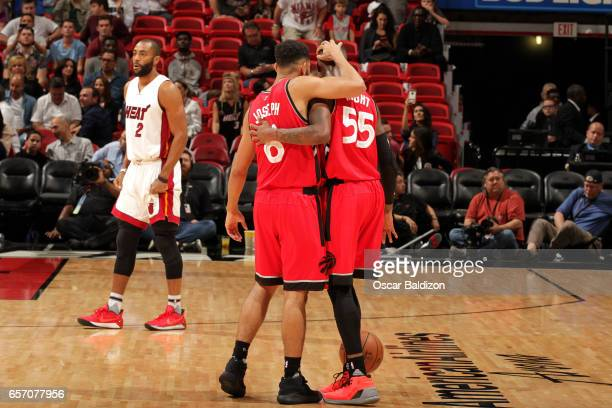Cory Joseph and Delon Wright of the Toronto Raptors share a hug during the game against the Miami Heat on March 23 2017 at AmericanAirlines Arena in...