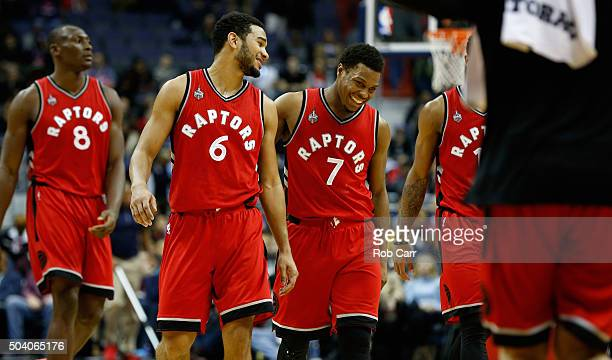 Cory Joseph and Kyle Lowry of the Toronto Raptors walk off the floor during a timeout in the second half of their 9788 win over the Washington...