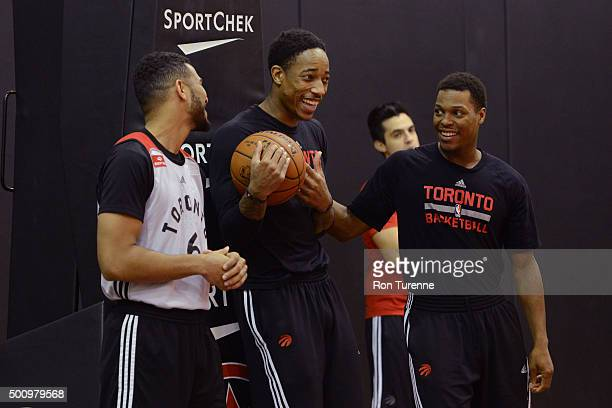 Cory Joseph Kyle Lowry and DeMar DeRozan of the Toronto Raptors smile and laugh during an open practice on December 6 2015 at the Air Canada Centre...