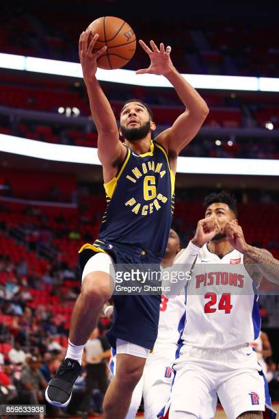 Cory Joseph of the Indiana Pacers gets to the basket past Eric Moreland of the Detroit Pistons during a pre season game at Little Caesars Arena on...