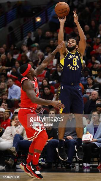 Cory Joseph of the Indiana Pacers shoots over Kay Felder of the Chicago Bulls at the United Center on November 10 2017 in Chicago Illinois The Pacers...