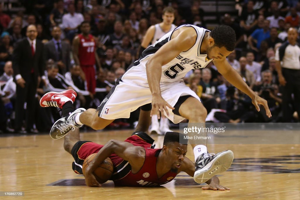 <a gi-track='captionPersonalityLinkClicked' href=/galleries/search?phrase=Cory+Joseph&family=editorial&specificpeople=5953537 ng-click='$event.stopPropagation()'>Cory Joseph</a> #5 of the San Antonio Spurs and <a gi-track='captionPersonalityLinkClicked' href=/galleries/search?phrase=Norris+Cole&family=editorial&specificpeople=5770147 ng-click='$event.stopPropagation()'>Norris Cole</a> #30 of the Miami Heat go after a loose ball in the second half during Game Three of the 2013 NBA Finals at the AT&T Center on June 11, 2013 in San Antonio, Texas.