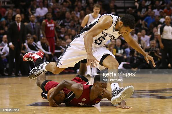 Cory Joseph of the San Antonio Spurs and Norris Cole of the Miami Heat go after a loose ball in the second half during Game Three of the 2013 NBA...